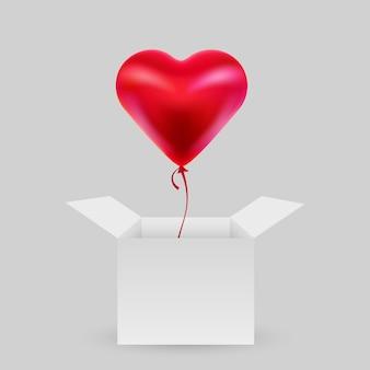Ballon en forme de coeur avec une boîte ouverte.