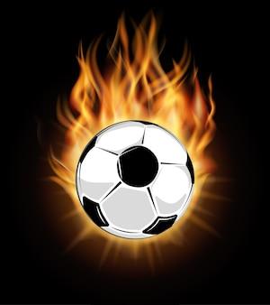Ballon de soccer brûlant isolé sur fond noir
