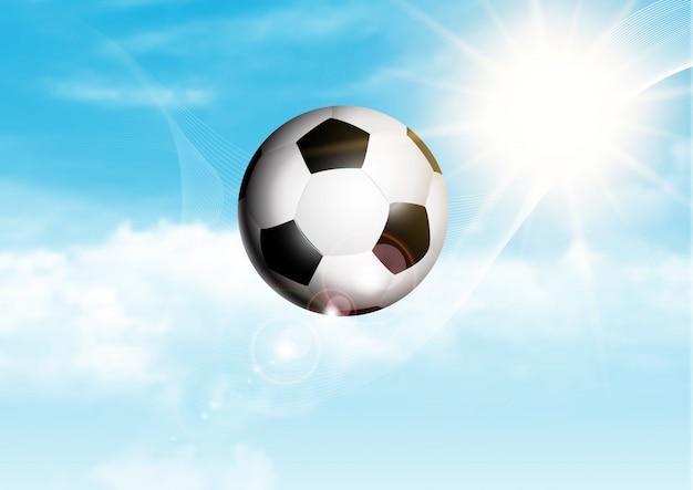 Ballon de soccer dans le ciel bleu