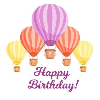 Ballons à air chaud colorés et texte joyeux anniversaire.