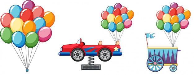 Ballons colorés avec voiture et chariot