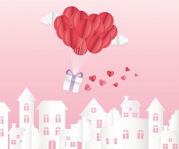 Ballons en papier origami joyeux saint valentin avec paysage urbain cadeau coeurs