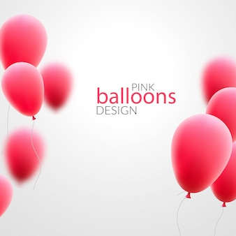 Ballons roses sur fond blanc