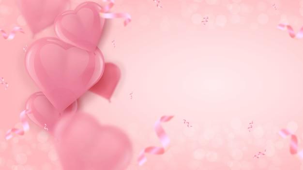 Ballons roses en forme de coeur d'air.