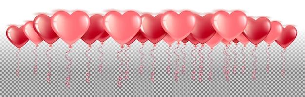 Des ballons rouges et roses sont suspendus à la bannière horizontale du plafond. pour la saint valentin