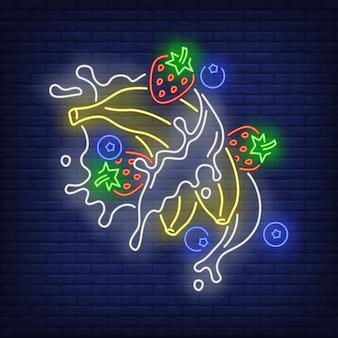 Bananes, fraises, bleuets et éclaboussures enseigne au néon