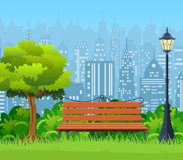 Banc avec arbre et lanterne dans le parc.
