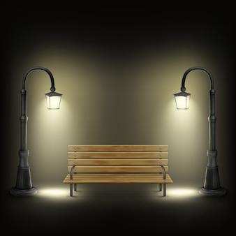 Banc éclairé par des lampadaires.