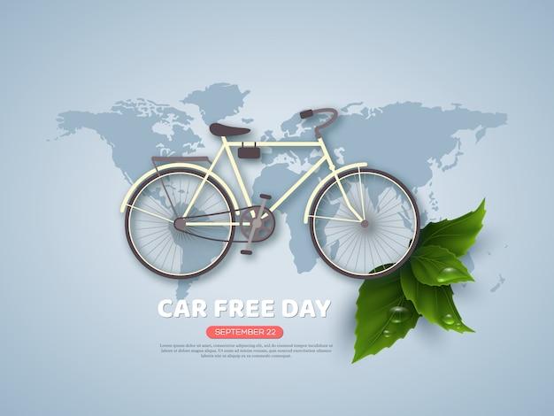 Bannière ou affiche de jour férié sans voiture. vélo de style papier découpé, feuilles réalistes avec des gouttes d'eau. fond de couleur bleu carte monde, illustration vectorielle.