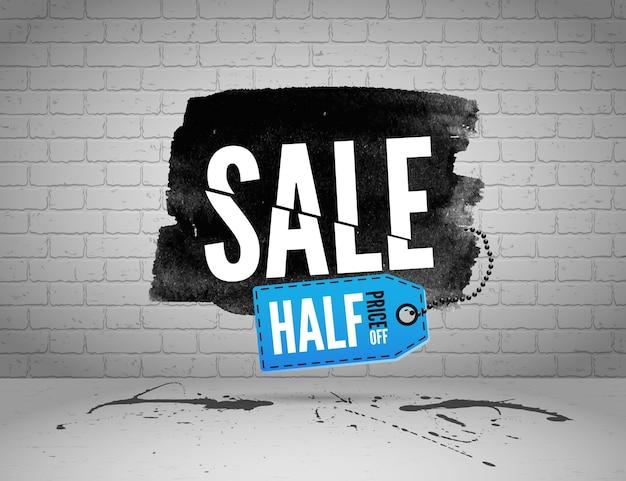 Bannière aquarelle de vente à moitié prix avec des touches d'encre sur fond grunge de brique