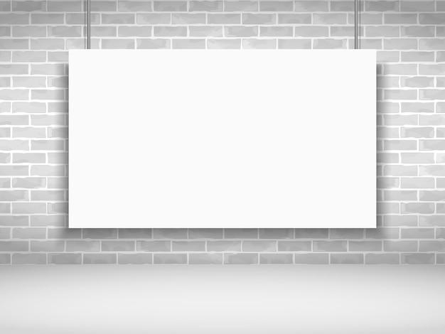 Bannière blanche vierge sur le mur de briques
