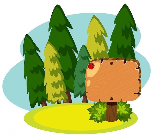 Bannière en bois dans la forêt verte