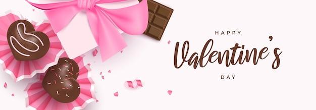 Bannière de bonne saint-valentin avec desserts coeur mignon, barre de chocolat, coffret cadeau