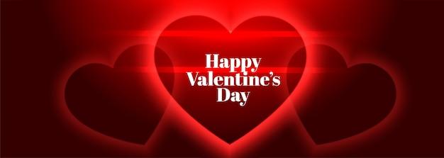 Bannière de coeurs rouges lumineux joyeux saint valentin