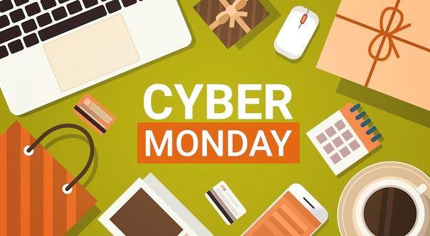 Bannière cyber monday avec clavier d'ordinateur portable, sacs, tablette et smartphone
