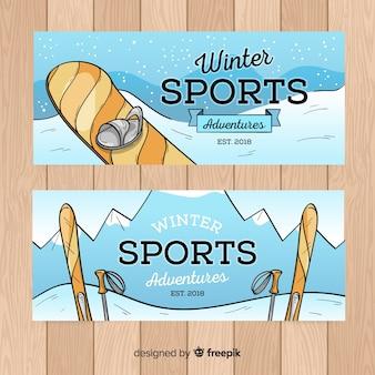 Bannière dessinée de sports d'hiver à la main
