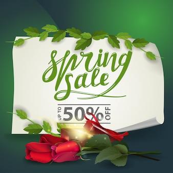 Bannière discount vente de printemps avec roses avec cadeau