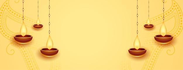 Bannière dorée joyeux diwali avec diya suspendu