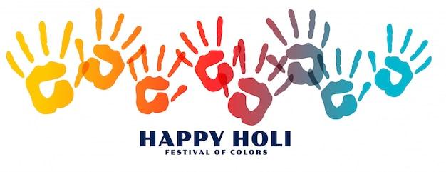Bannière d'empreintes de mains colorées happy holi