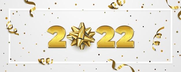 Bannière de fond de bonne année 2022 avec le nombre d'or et la décoration d'arc cadeau
