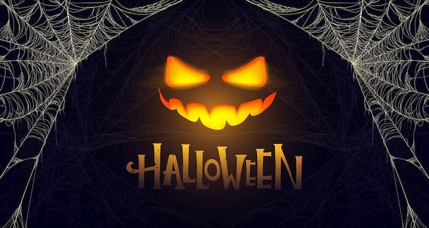 Bannière d'halloween avec citrouille rougeoyante et toile d'araignée. premium.