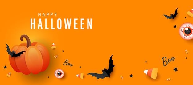 Bannière d'halloween heureux. citrouille orange, bonbons de couleur, gros yeux.bats sur fond orange. affiche de vacances horizontale, en-tête pour site web