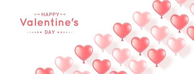 Bannière horizontale avec des ballons en forme de coeur rose sur fond blanc. romantique réaliste pour la saint-valentin