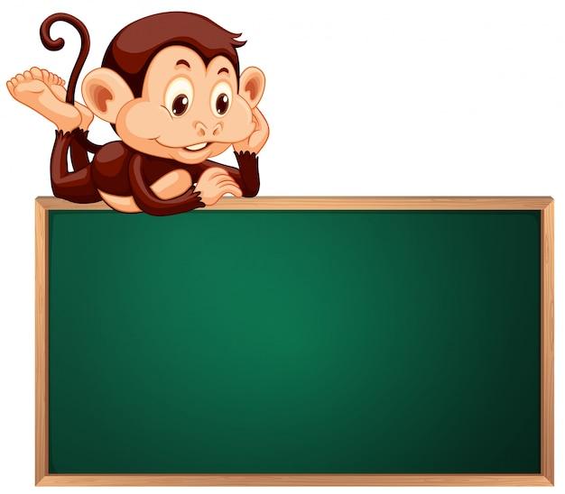 Une bannière mignonne de singe et de tableau noir