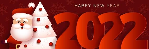 Bannière de noël avec le père noël et l'arbre de noël joyeux noël et bonne année bannière 2022