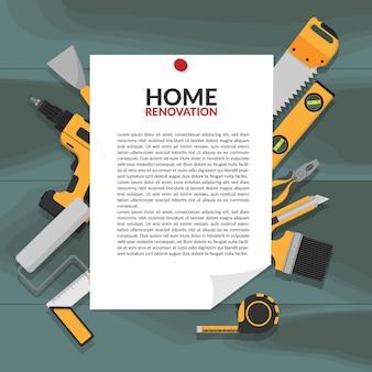 Bannière de notification papier avec broche principale de rénovation domiciliaire sur planche de bois