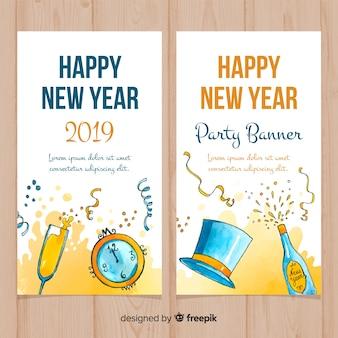 Bannière de nouvel an éléments dessinés à la main parti
