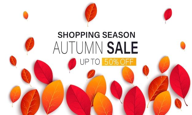 Bannière pour la vente d'automne avec des feuilles d'automne colorées et saisonnières et rowan pour la promotion de shopping discount