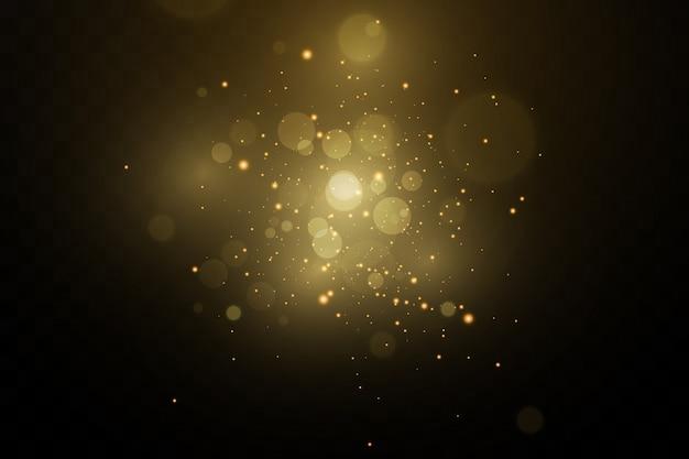 Bannière avec de la poussière jaune. effet de lumière sur de belles bannières. effet poussière. les particules de poussière scintillent sur un fond sombre.