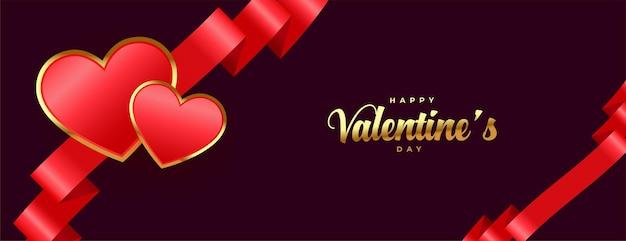 Bannière premium joyeux saint valentin avec ruban et coeurs