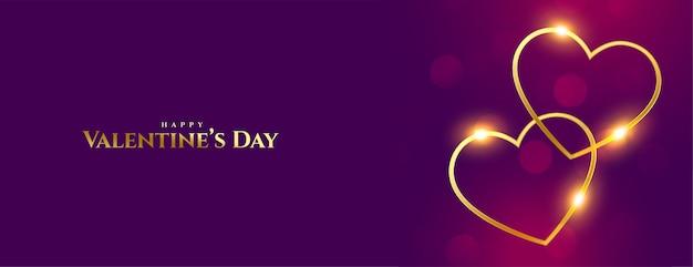 Bannière premium de la saint valentin deux coeurs dorés brillants