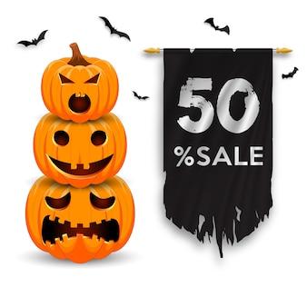 Bannière de promotion de vente halloween avec citrouilles, chauves-souris et drapeau en lambeaux.