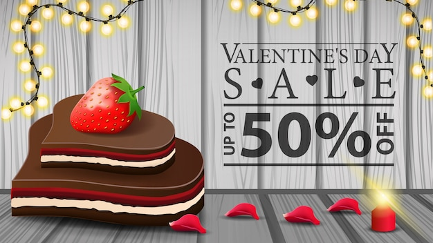 Bannière de réduction horizontale de la saint-valentin avec des bonbons au chocolat
