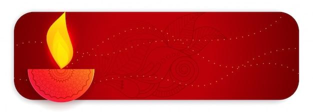 Bannière rouge avec une lampe créative de joyeux diwali diya