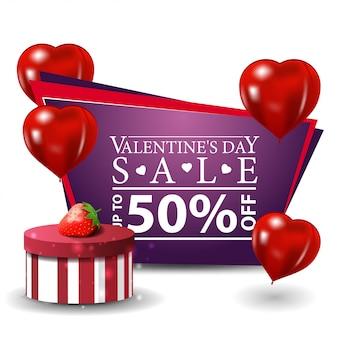 Bannière de la saint-valentin avec des ballons en forme de coeur et un cadeau