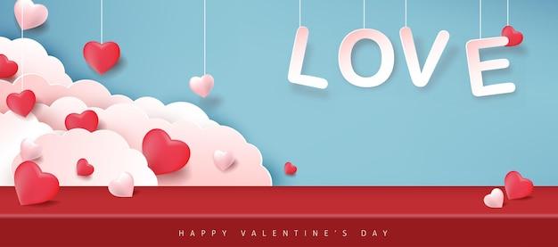 Bannière de la saint-valentin avec des ballons en forme de coeur.