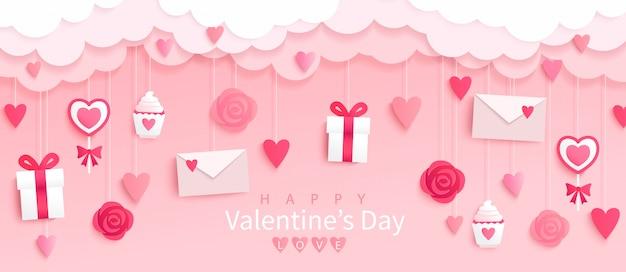 Bannière de la saint-valentin avec des cadeaux, des coeurs, des lettres, des fleurs en fond rose avec des voeux de joyeuses fêtes, style origami.