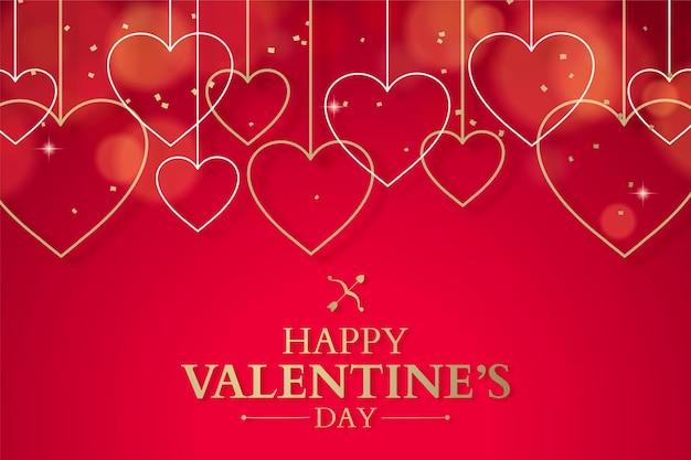 Bannière de la saint-valentin avec des coeurs suspendus en or, fond rouge romantique