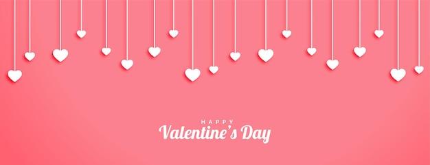 Bannière de la saint-valentin avec conception de coeurs suspendus