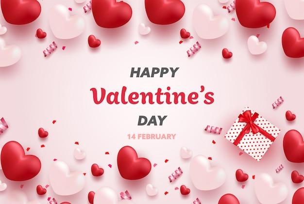 Bannière de la saint-valentin heureuse avec des coeurs de luxe rouges et roses et de beaux éléments.