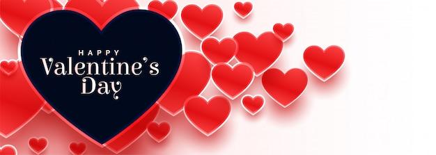 Bannière de la saint-valentin avec de nombreux coeurs rouges