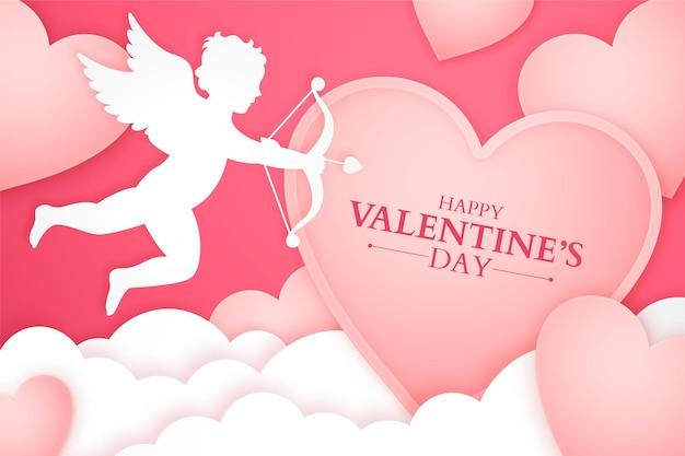 Bannière de la saint-valentin avec silhouette de cupidon et nuages de papier et coeurs, fond de papier découpé romantique