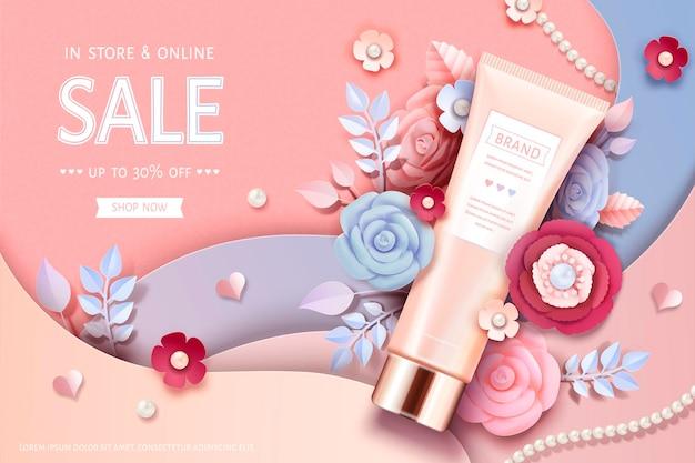 Bannière de tube cosmétique avec de belles fleurs en papier en rose pêche