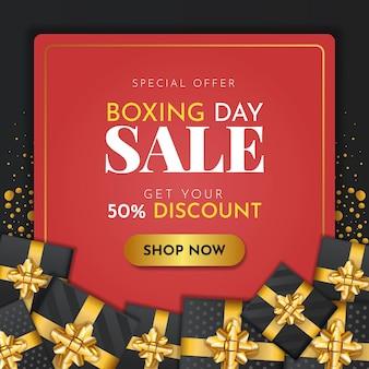 Bannière de vente du lendemain de noël avec des coffrets cadeaux noirs et des rubans dorés
