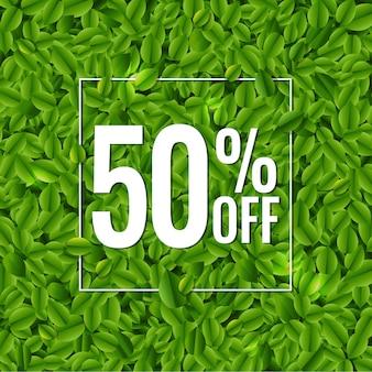 Bannière de vente avec fond de feuilles vertes
