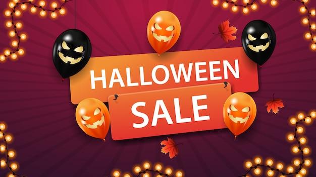Bannière de vente halloween, bannière de remise avec des ballons d'halloween et des feuilles de l'automne